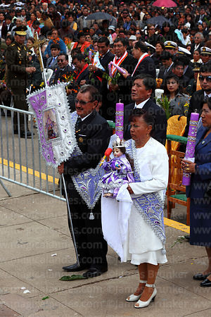 Hosting family (alferado) waiting to receive holy communion during central mass, Virgen de la Candelaria festival, Puno, Peru