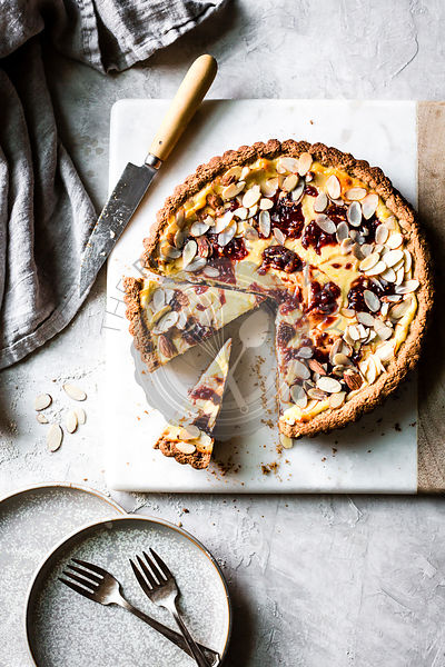 Italian Jam and Ricotta Tart on a gray background