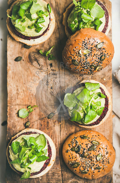 Flat-lay of healthy vegan burgers with beetroot patties, copy space