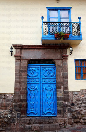 Ornate blue wooden door of colonial building, Cusco, Peru