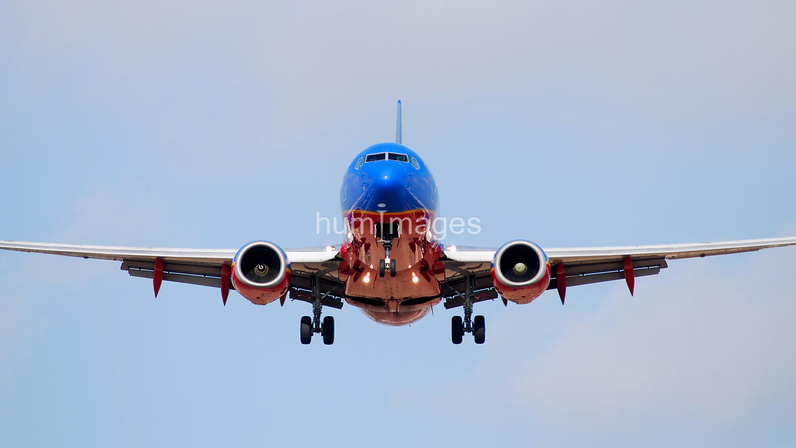 Full image of Southwest Airlines plane landing at Love Field in Dallas, Texas