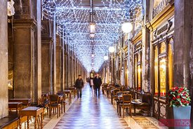 St Marks square's colonnade with Christmas lights, Venice, Italy