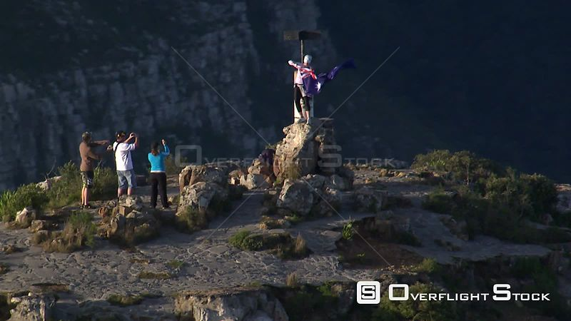 Aerial of tourists flying an Australian flag on the summit of Lion's Head in Cape Town. Cape Town Western Cape South Africa