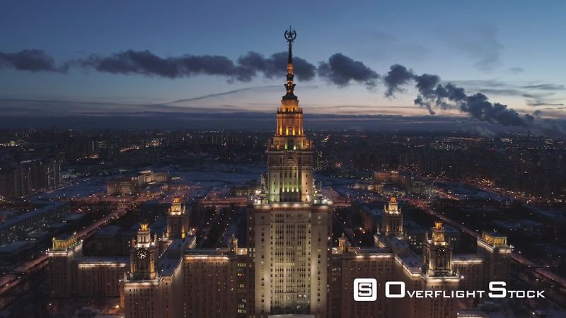 Moscow State University and Illuminated Moscow Skyline at Winter Evening. Russia. Aerial View. Drone is Flying Forward and Approaching. Establishing Shot.