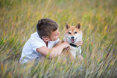 Small Dog With Boy Outdoors