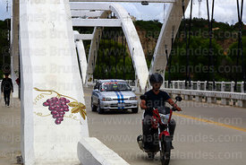 Grape mural and traffic crossing Puente Peregrino / Pilgrim Bridge, Tarija, Bolivia