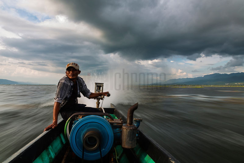 Boat Driver Ferrying Tourists to their Hotel on Inle Lake