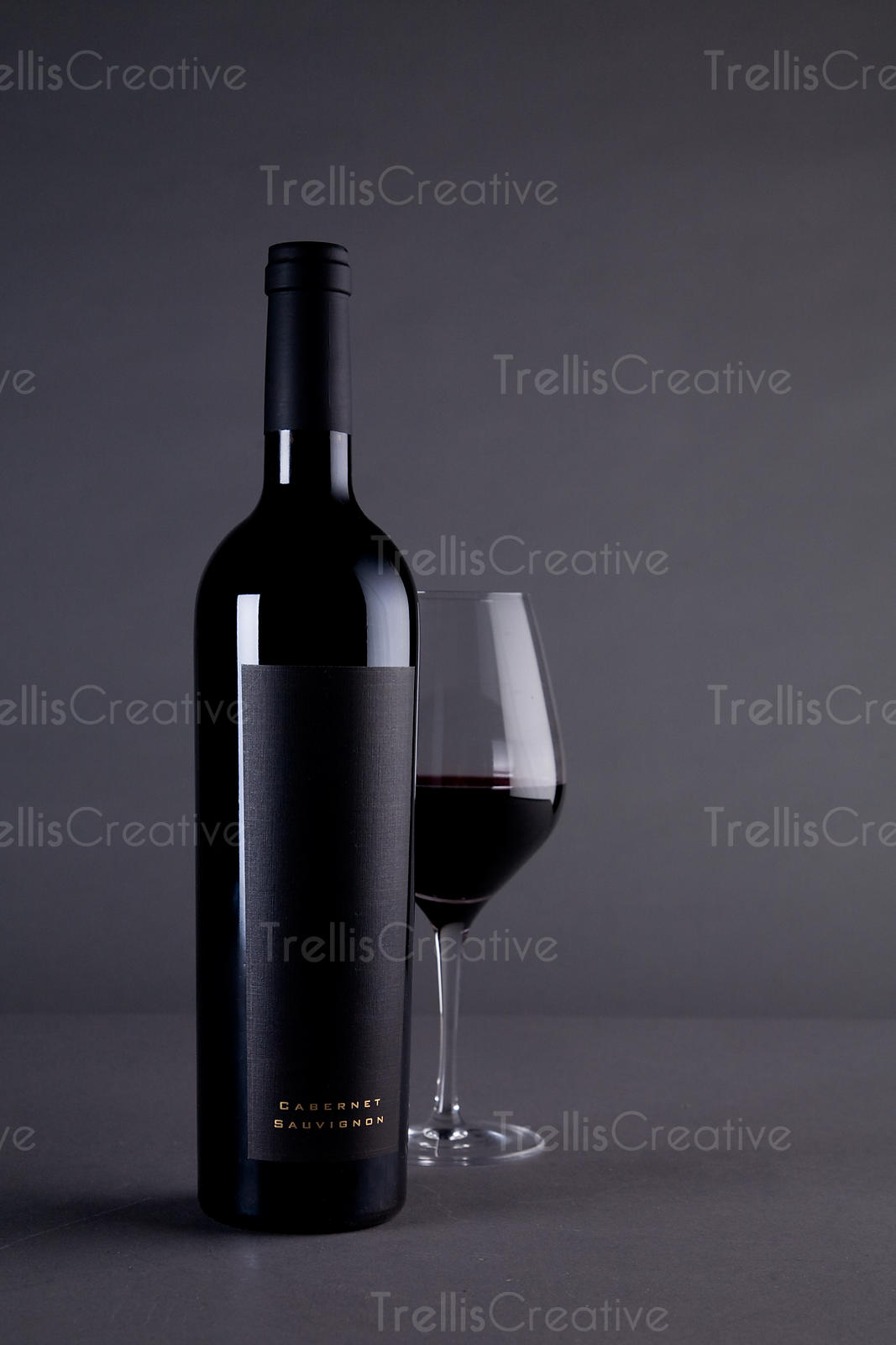 Red Bordeaux wine magnum bottle with blank black label