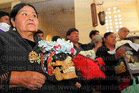 Aymara woman with her skull in church during mass, Ñatitas festival, La Paz, Bolivia