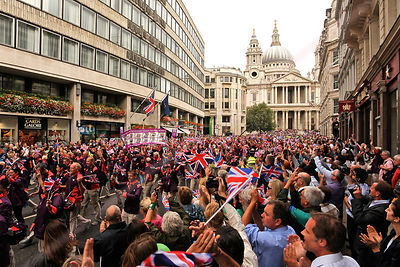 Games Maker Volunteers on the Athletes Victory Parade with St Pauls Cathedral Behind