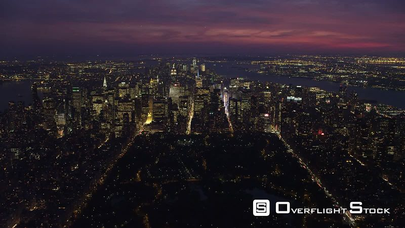 Flying toward Midtown Manhattan at dusk with Central Park in foreground, looking toward Upper New York Bay.