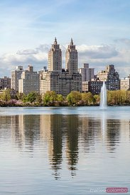 Buildings reflected in lake in Central Park in spring, New York, USA