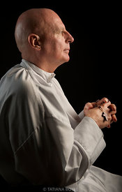 Catholic priest with the rosary