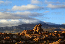 Eroded volcanic rock formations and Cerro Chuhuilla volcano, Nor Lípez Province, Bolivia