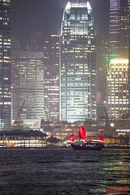 Chinese junk sail in Hong Kong harbor at night