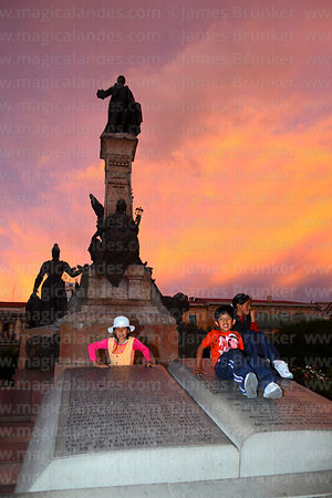 Children playing on Proclamation of the Junta Tuitiva in front of Murillo monument, Plaza Murillo, La Paz, Bolivia