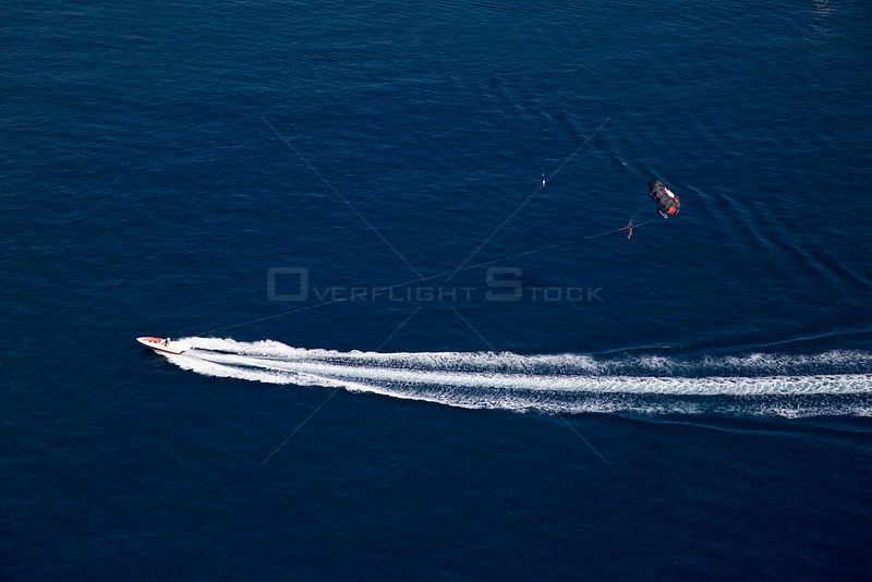 Motorboat towing a paraglider off Cannes, France.