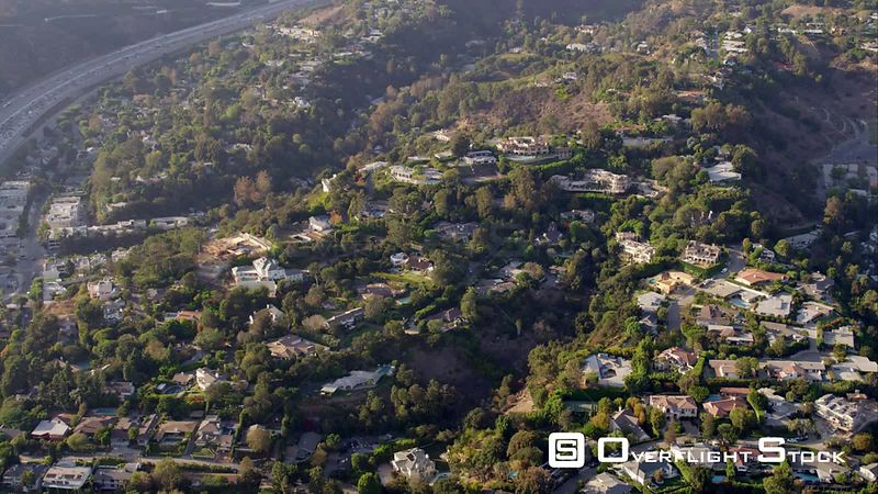 Aerial View Of Houses In The Bel Air Area Of Los Angeles, The 405 Freeway And The Getty Center, RED R3D 4k California