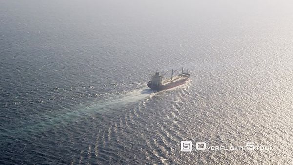 Aerial View of Bulk Carrier Steaming Into the Sun in the Atlantic Ocean, Spain