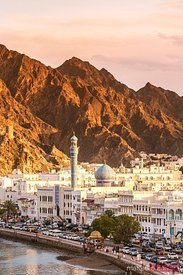 Oman, Muscat. Cityscape of Mutrah old town at sunset