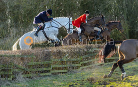 jumping a hedge at Town Park Farm - The Cottesmore at Town Park Farm