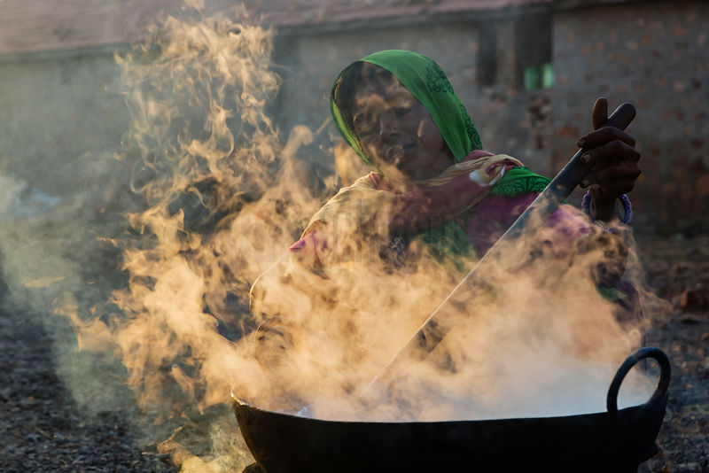 A Woman from the Bharwad Tribe Boiling Buffalo Milk for Sweet Production