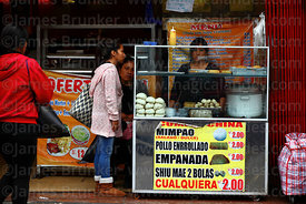 Kiosk selling local and Chinese snacks outside restaurant, Chinatown, Lima, Peru