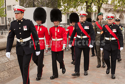 Members of the Forces walking to Westminster Abbey