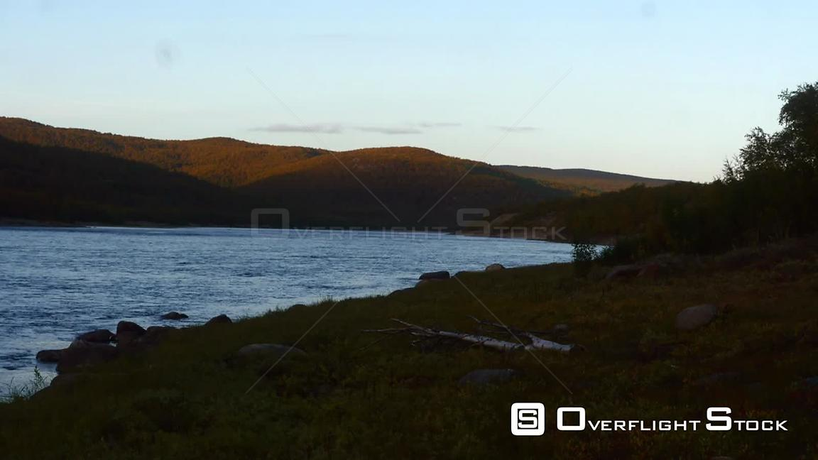 Autumn River, Time Lapse View of Tenojoki River at the Border Between Norway and Utsjoki Town, on a Sunny Autumn Evening Dawn, in Utsjoki, Lapland, Lappi, Finland