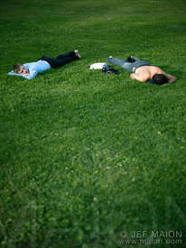 2 young men lying in grass