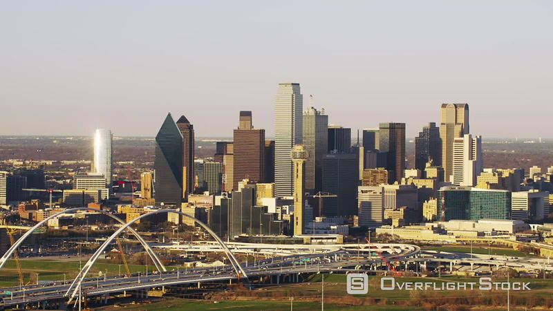 Dallas, Texas Aerial view of Margaret McDermott arch bridge and city buildings