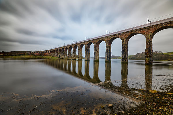 Royal border bridge over the river Tweed. with reflections in the river, against a cloudy sky.