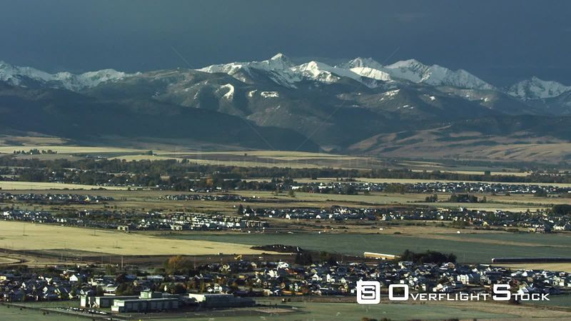 The Spanish peaks of the Madison mountain Range tower above Bozeman, Montna and the Gallatin Valley