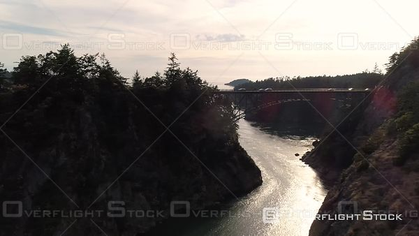 Drone dolly of cars driving over Deception Pass bridge at Canoe Pass in Washington