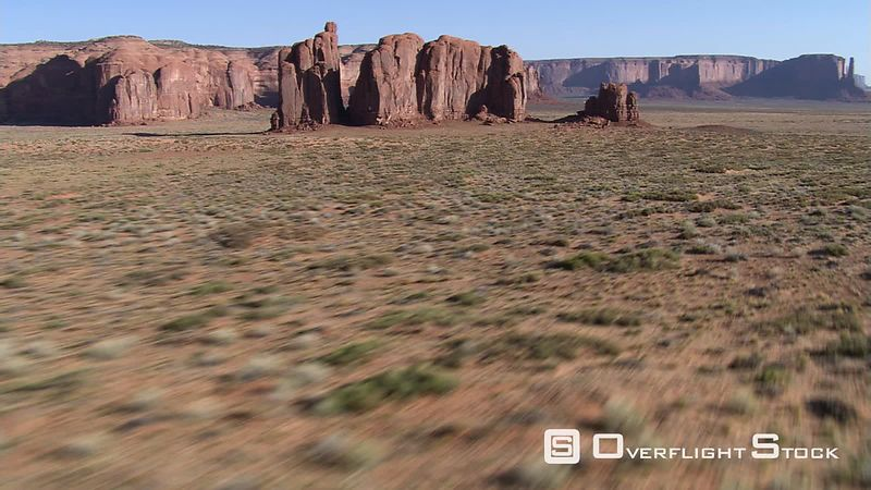 Fast flight through notch in Monument Valley rock formation