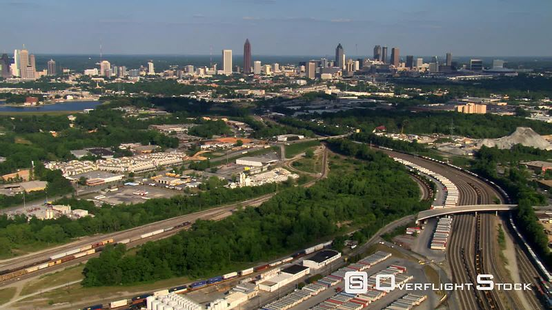 Flying over railyard to distant view of Midtown Atlanta, Georgia.