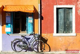 Bicycle in front of colorful house, Burano, Venice