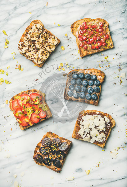 Vegan whole grain toasts with fruit, seeds, nuts, top view