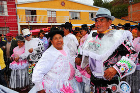 Ch'uta dancing with cholita at San Antonio de Abad festival in Caquiaviri, Bolivia