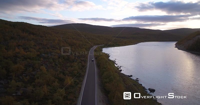 Autumn Color Road, Aerial View Following a Car Driving on Road 970 the Tenontie, Near Tenojoki River, at the Border of Norway and Utsjoki, on a Sunny Evening Dawn, in Lapland, Finland