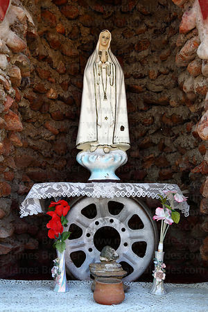 Virgin Mary figure in shrine inside railway station , Tacna , Peru