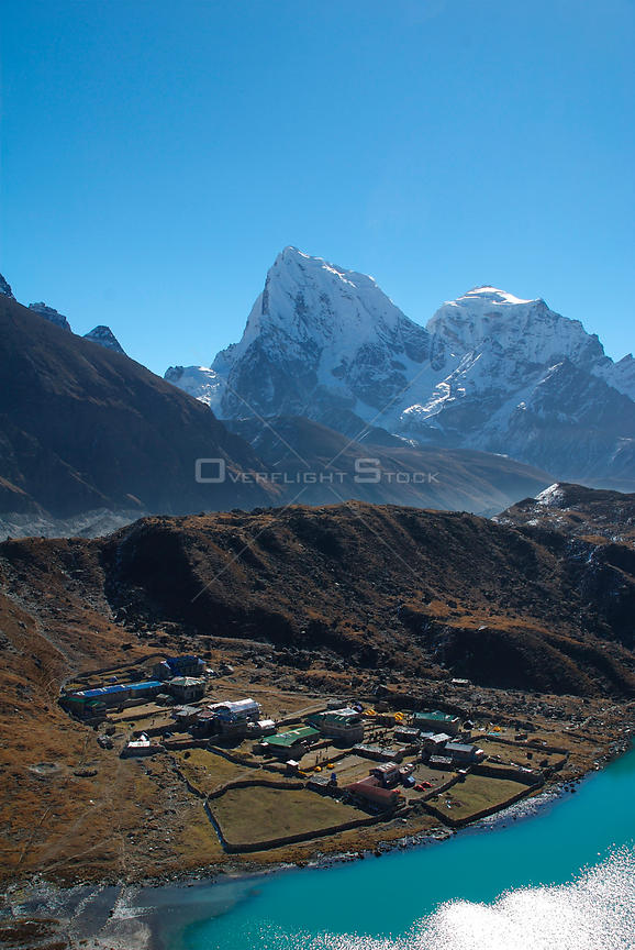 NEPAL Gokyo Peak -- A view of Gokyo - largely a collection of lodges rather than a village - from Gokyo Ri, with Mount Cholatse (6335m, left) and Mount Taboche (6367m, right).