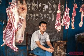 Uyghur butcher at the market, Xinjiang, China