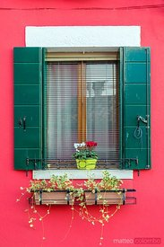 Typical window on a colorful house, Burano, Venice