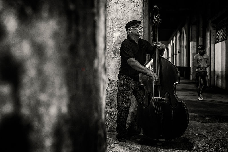 Bass Player in the Street at Night
