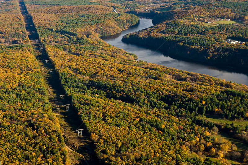 Aerial view of power lines cutting a swath through forest next to the Connecticut River in Gill, Massachusetts, USA, November 2007