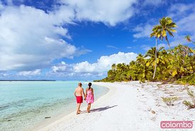 Couple of tourists walking on beach, Cook Islands