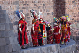 Inca officials on wall of Coricancha / Sun Temple at start of Inti Raymi festival, Cusco, Peru