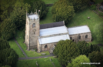 aerial photograph of Saint John the Baptist Church Mayfield Staffordshire England UK
