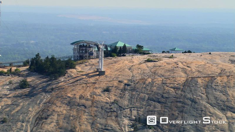 Aerial zoom-out to carving on Stone Mountain, Georgia.